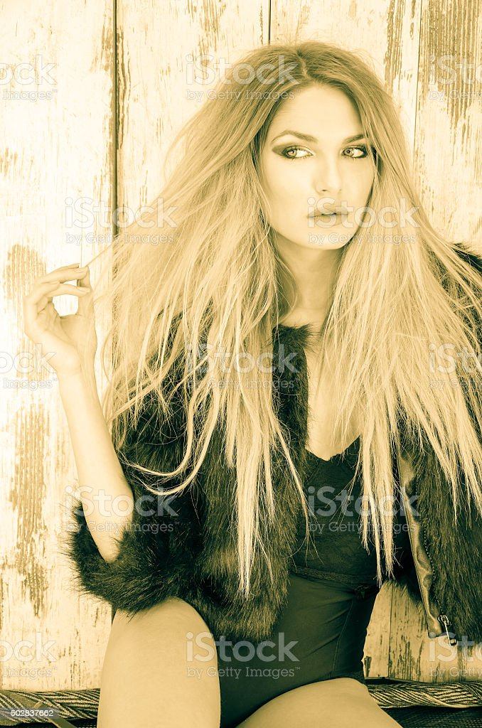 Blonde with a black coat stock photo