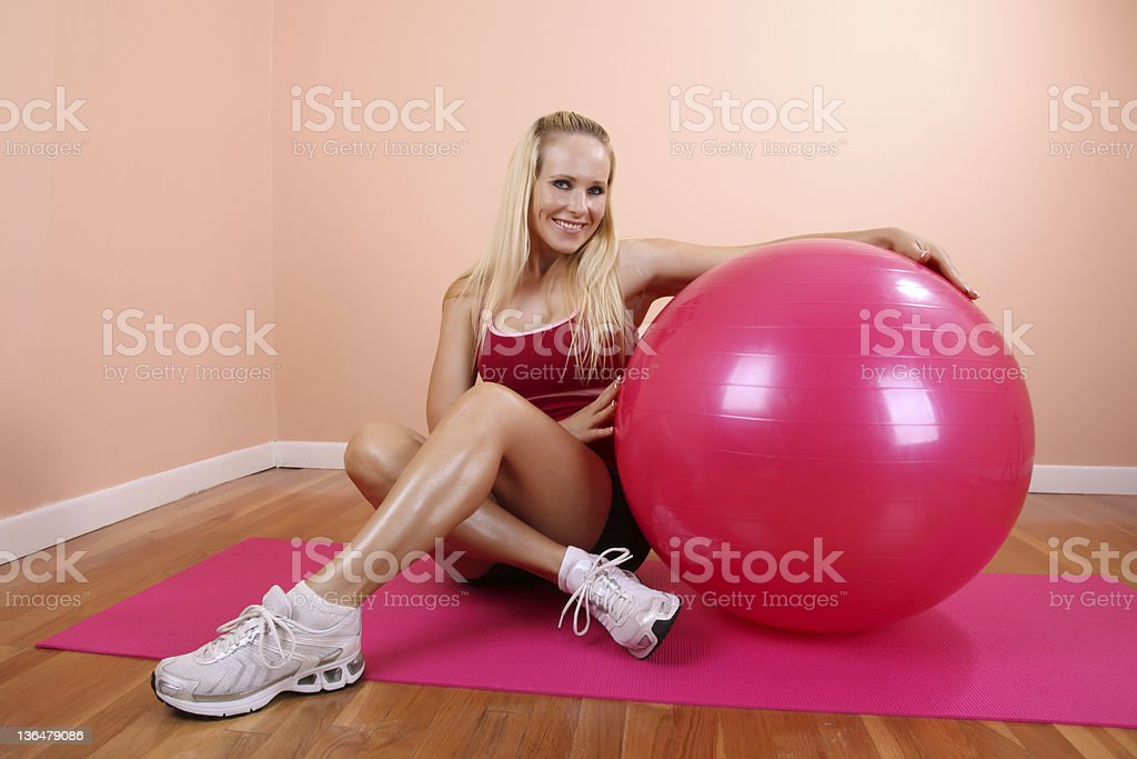 Blonde with a Pilates Ball royalty-free stock photo