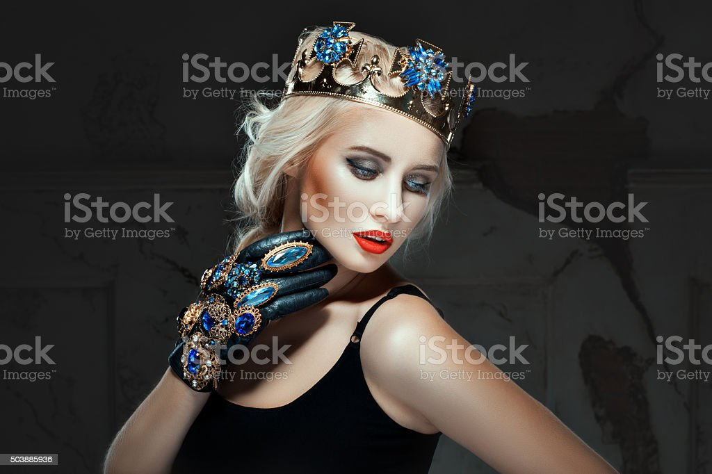 Blonde with crown his head and make-up  her face. stock photo