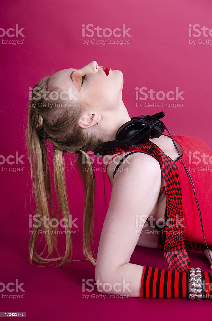 Blonde with headphones leaning head back. royalty-free stock photo