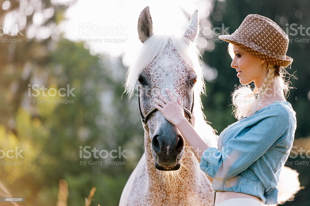 Blonde with horse royalty-free stock photo