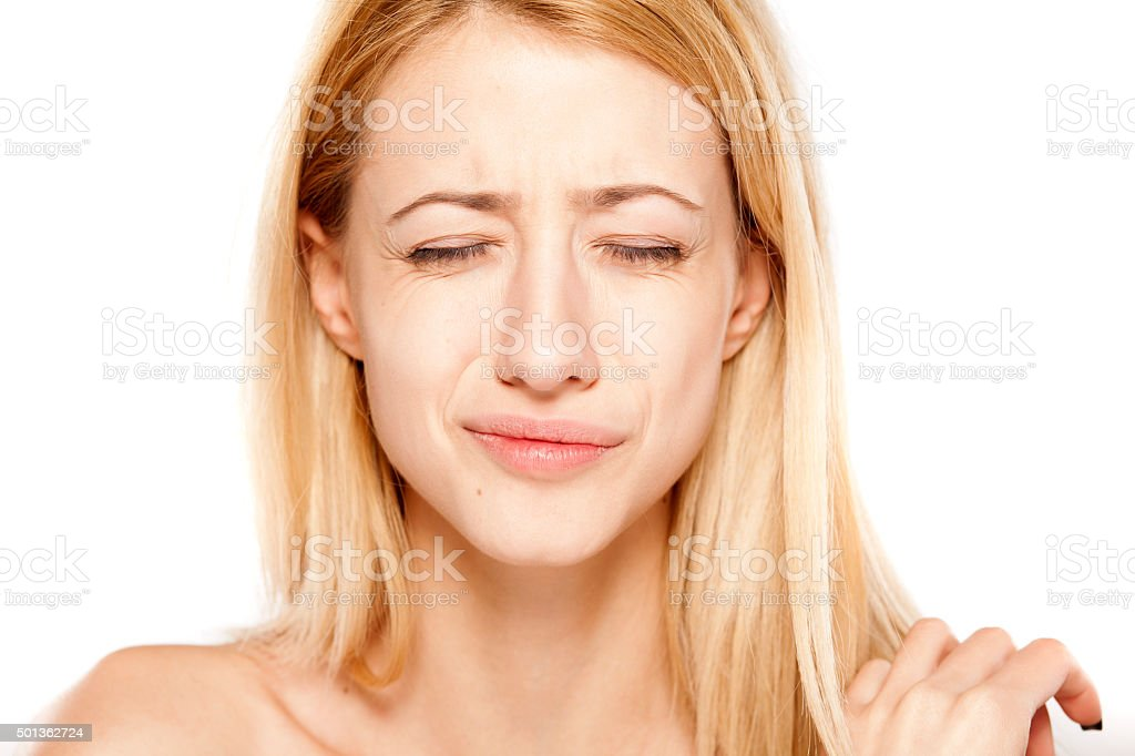 blonde with painful expression stock photo