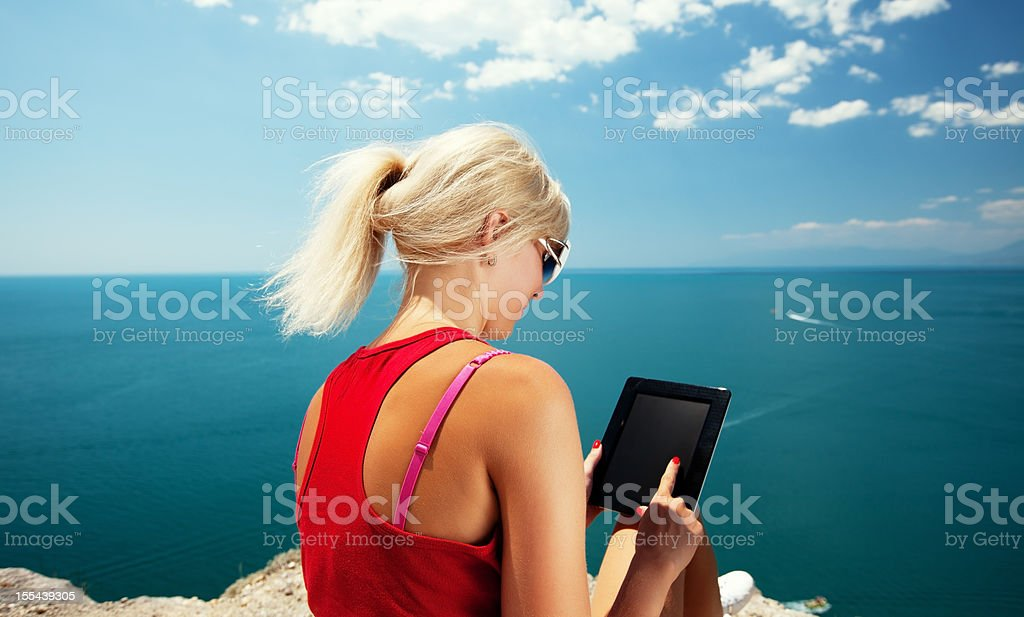 Blonde with tablet stock photo