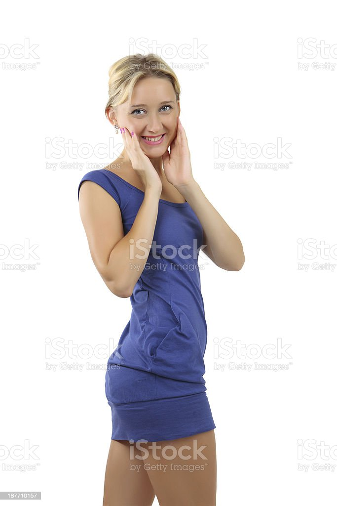 Blonde woman, 34 years old, in a short blue dress. stock photo