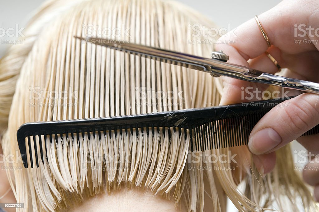Blonde woman at hair saloon stock photo