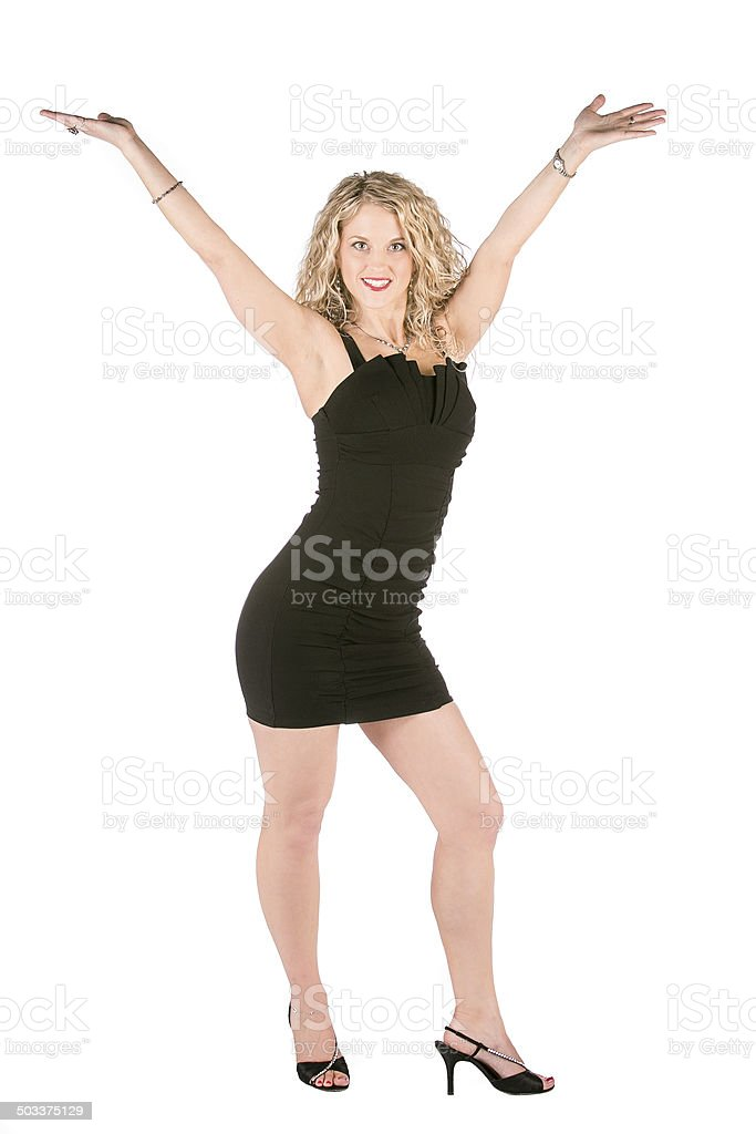 blonde woman black dress arms outstretched stock photo