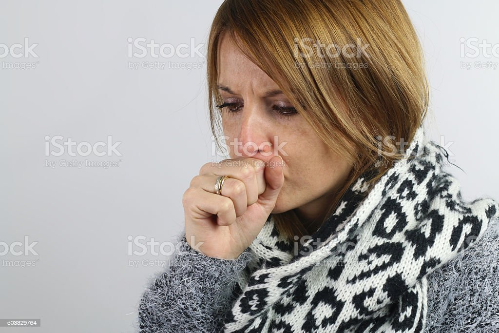 blonde woman coughing stock photo
