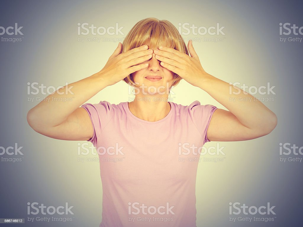 Blonde Woman Covering Her Eyes, stock photo