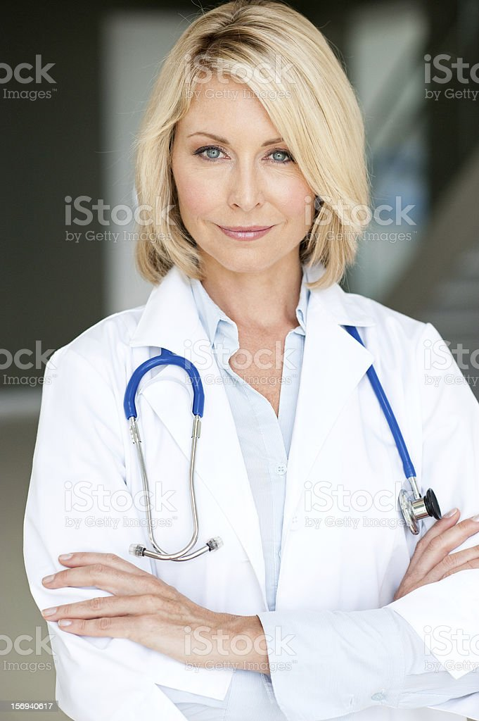 Blonde Woman Doctor in Office stock photo