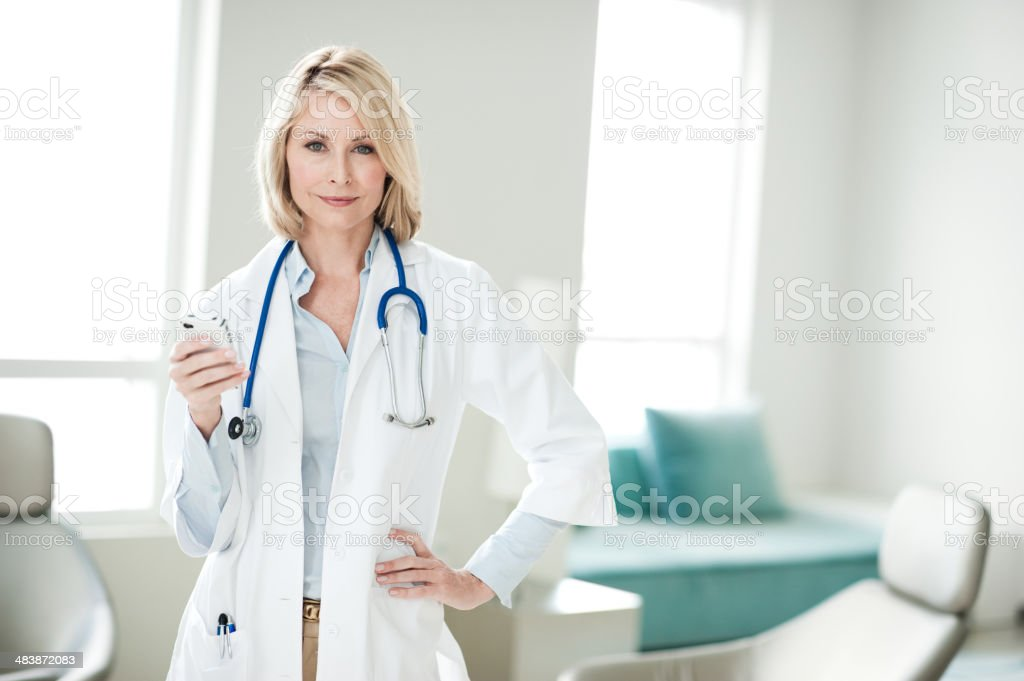 Blonde Woman Doctor in Office royalty-free stock photo