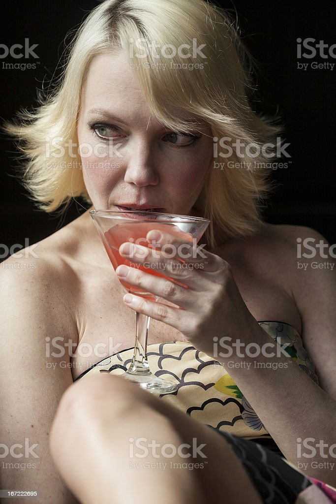 Blonde Woman Drinking a Pink Martini royalty-free stock photo