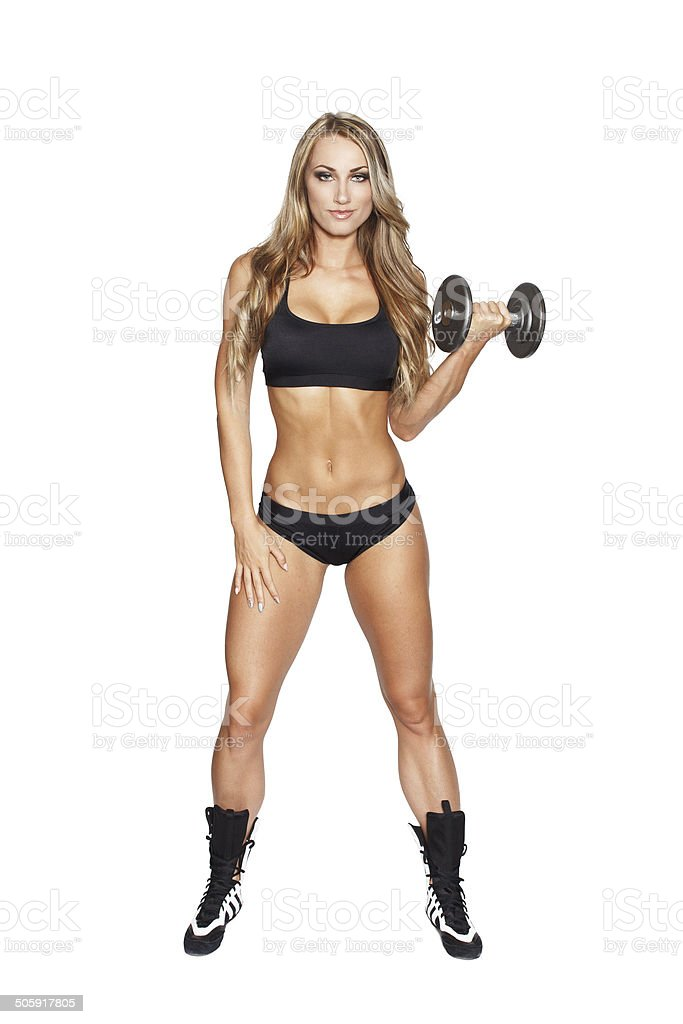 Blonde woman exercise with dumbbell royalty-free stock photo