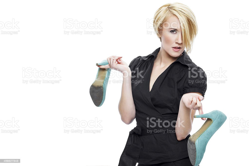 Blonde woman holding high heels royalty-free stock photo