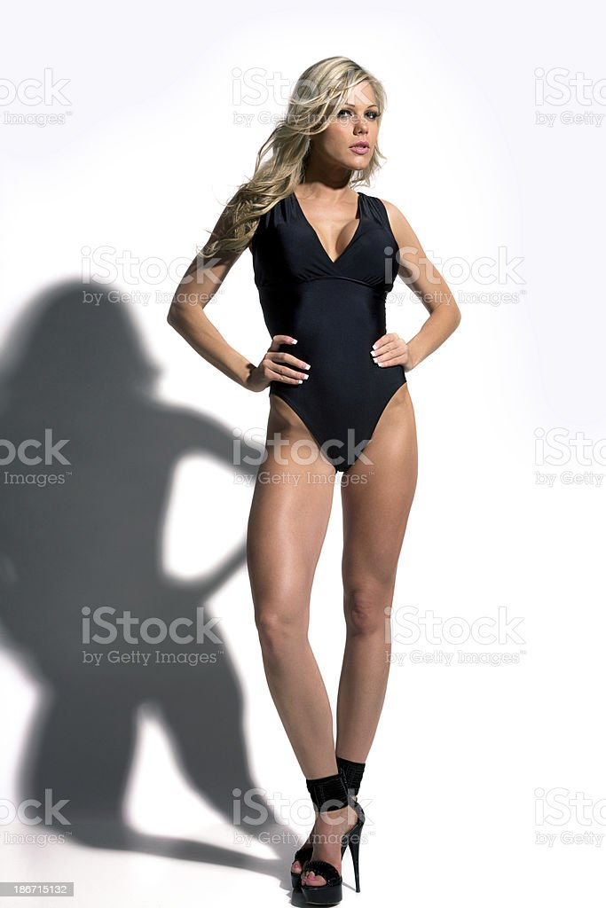 Blonde Woman In Black Swimsuit royalty-free stock photo