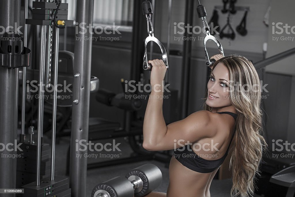 Blonde woman in gym workout royalty-free stock photo