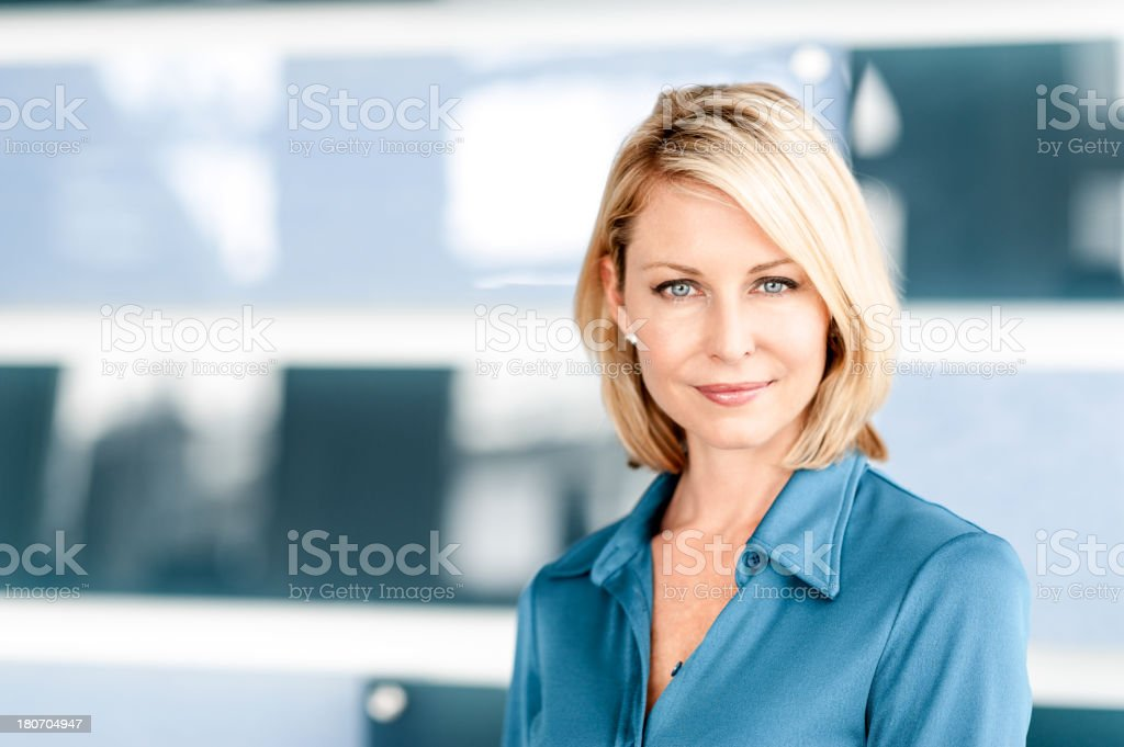 Blonde Woman in Modern Home royalty-free stock photo