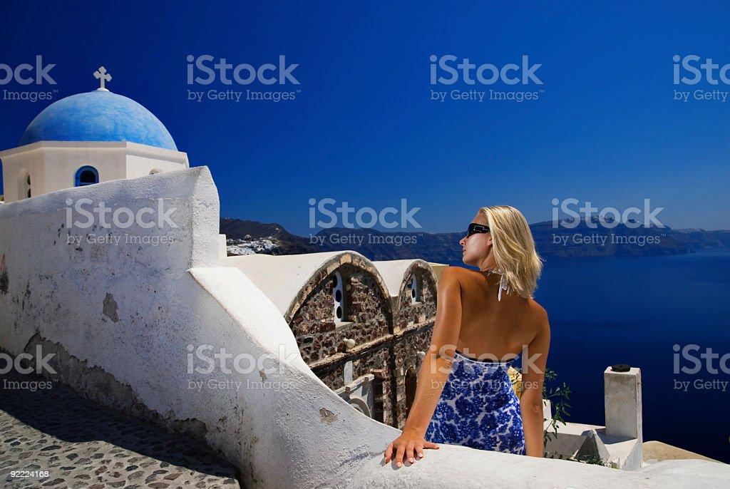 A blonde woman on Santorini Island in Greece royalty-free stock photo