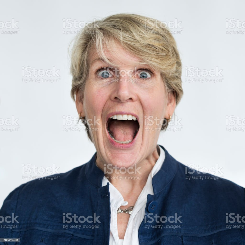 Blonde woman open mouth surprised portrait stock photo