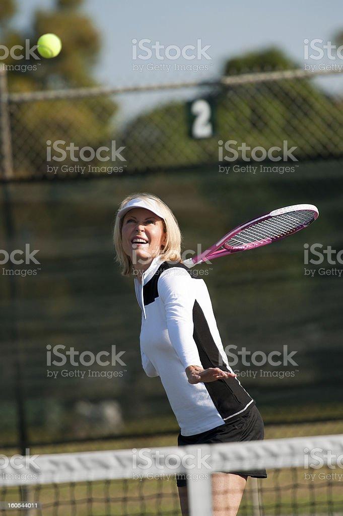 Blonde Woman Playing Tennis royalty-free stock photo