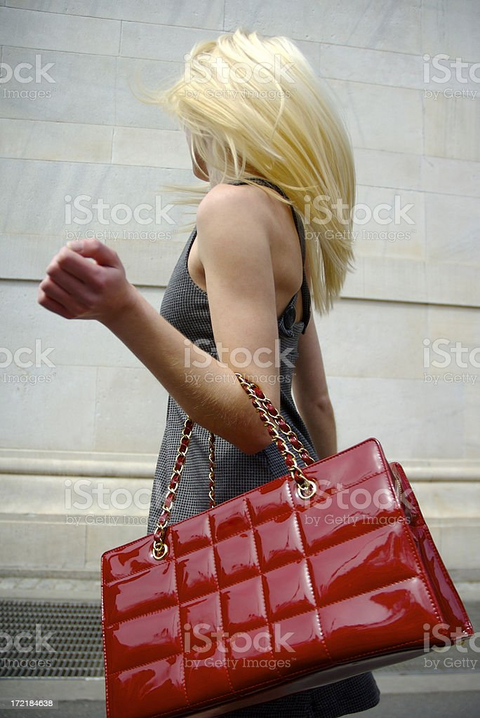 Blonde Woman Red Handbag Goes for a Whirl Outdoors royalty-free stock photo