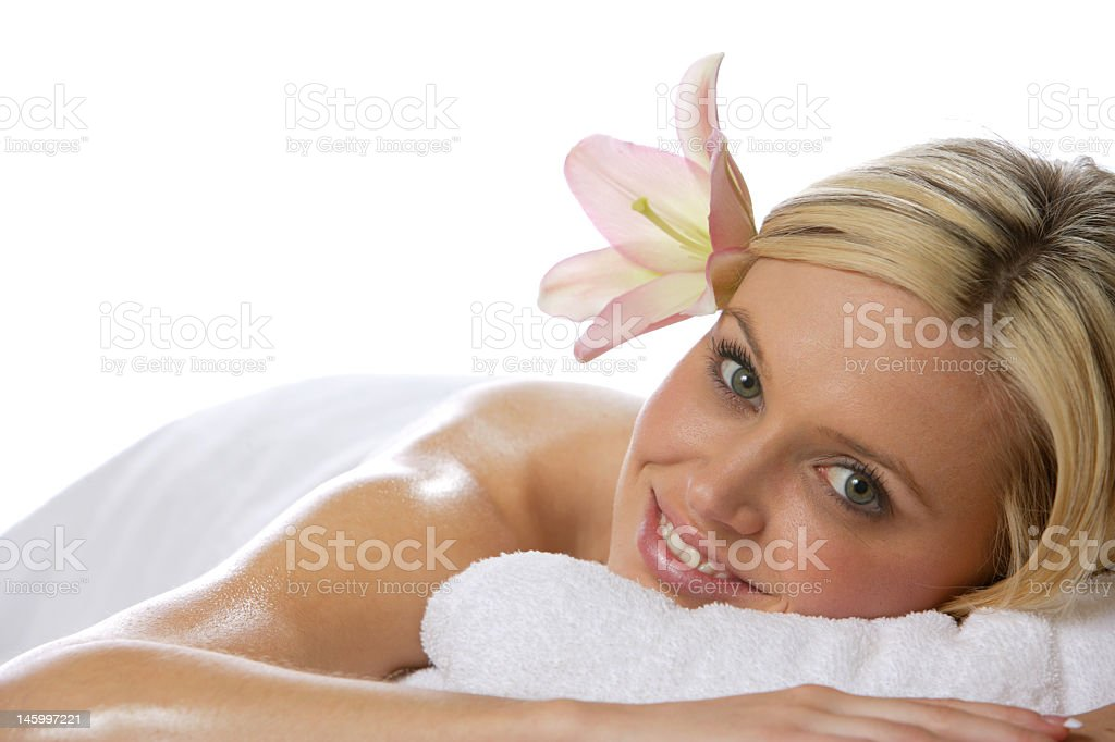 Blonde woman relaxing after a spa massage experience royalty-free stock photo
