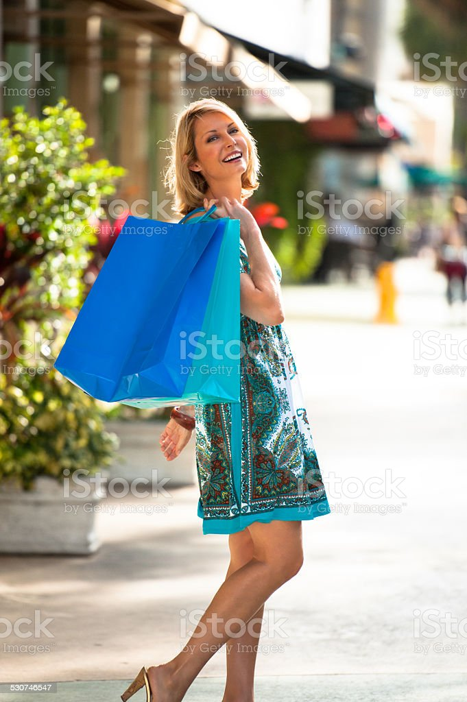 Blonde Woman Shopping with Bags stock photo