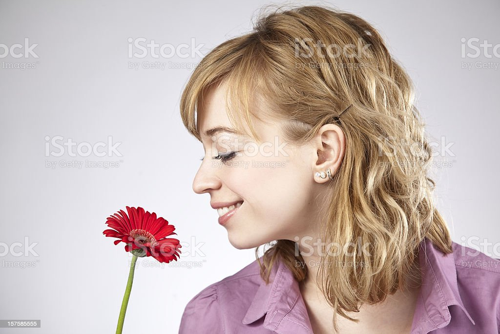 Blonde woman smelling flower royalty-free stock photo