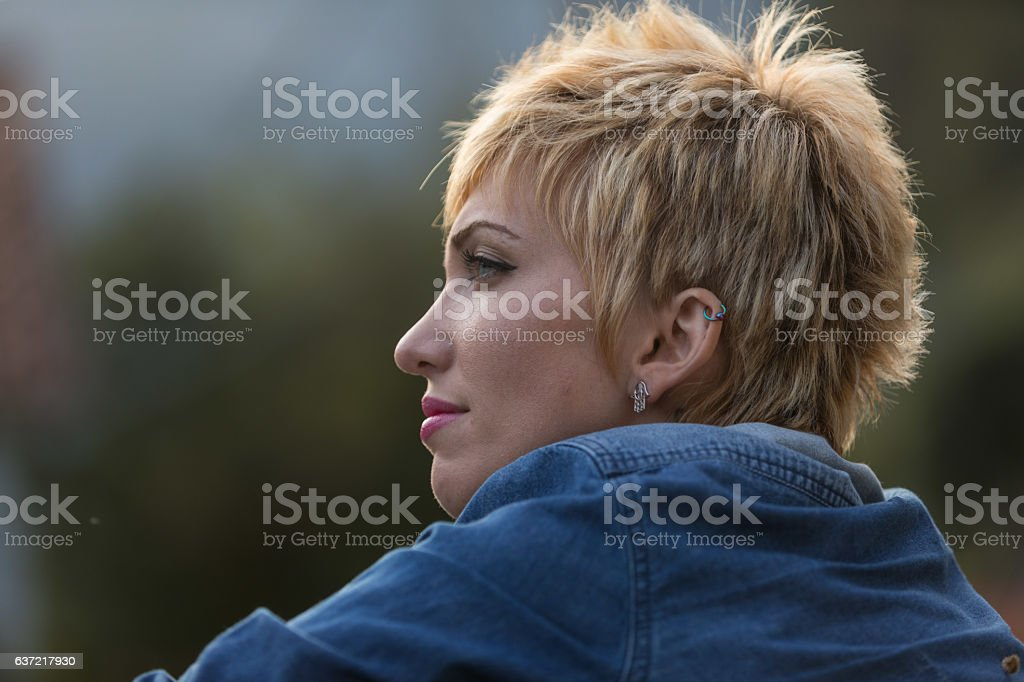blonde woman thinking outdoors portrait stock photo