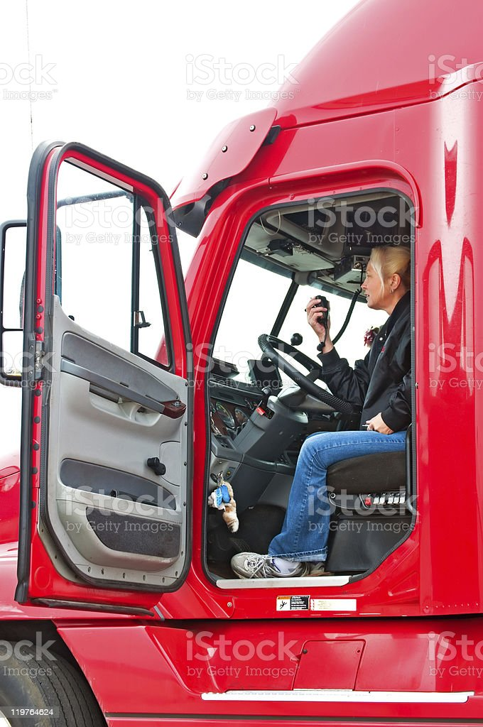 Blonde woman truck driver stock photo