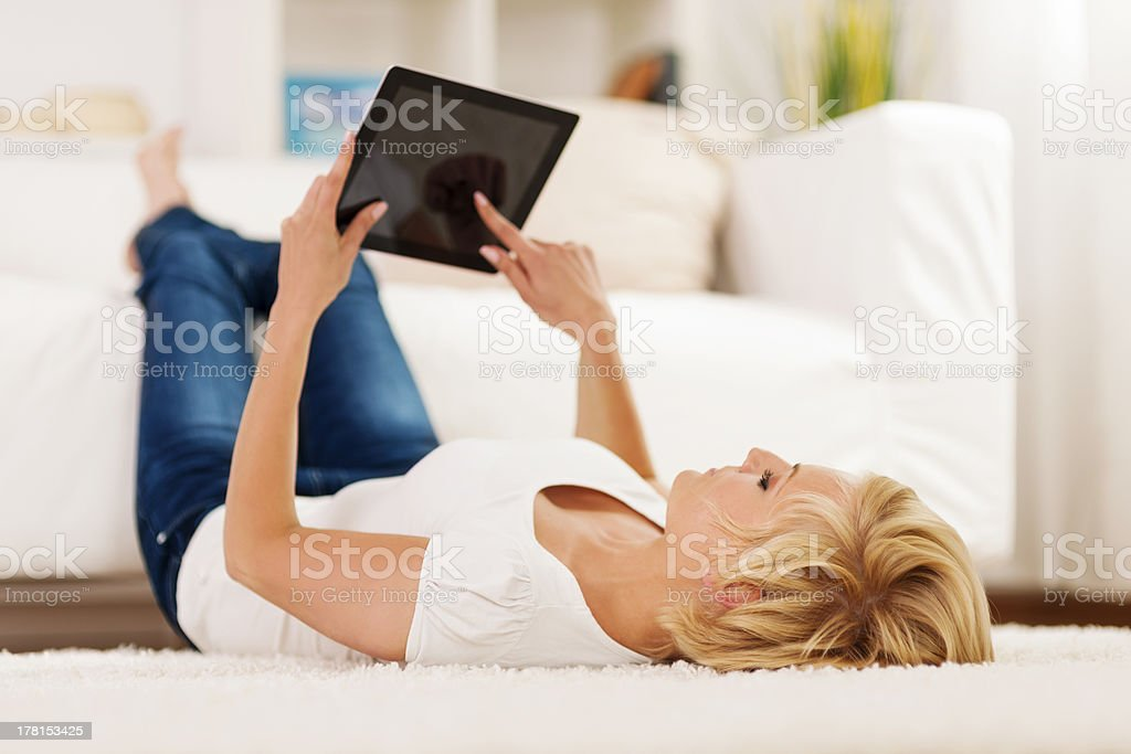 Blonde woman using digital tablet royalty-free stock photo