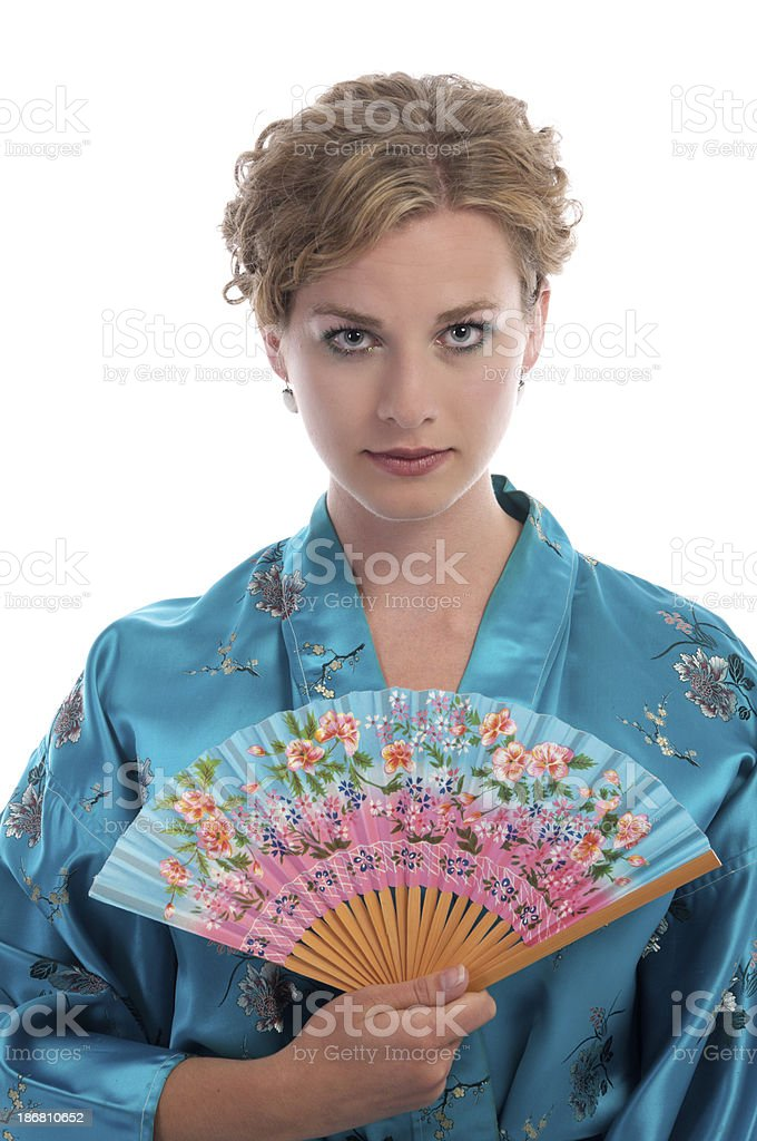 Blonde woman wearing a blue satin Chinese robe. stock photo