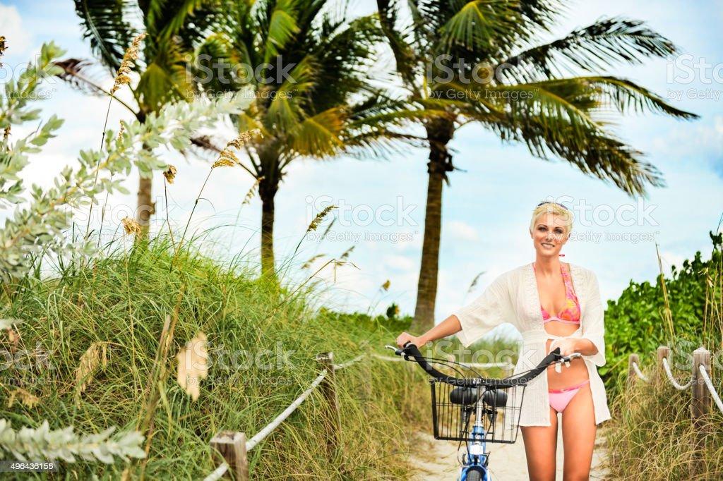 Blonde Woman with Beach Cruiser stock photo