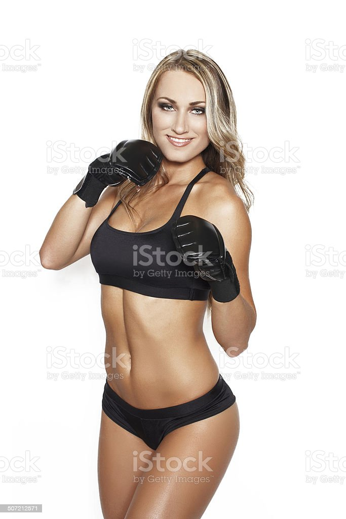 Blonde woman with black gloves boxing royalty-free stock photo