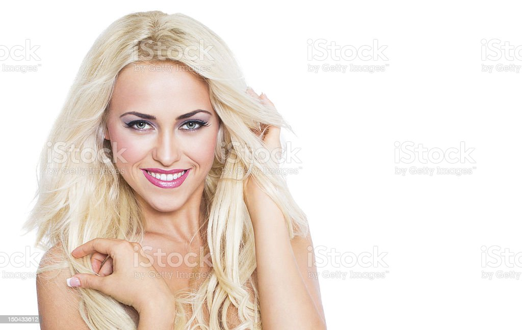 Blonde woman with blowing hair and smiling royalty-free stock photo