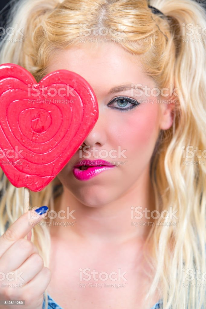 Blonde woman with blue eyes and heart in Hand stock photo