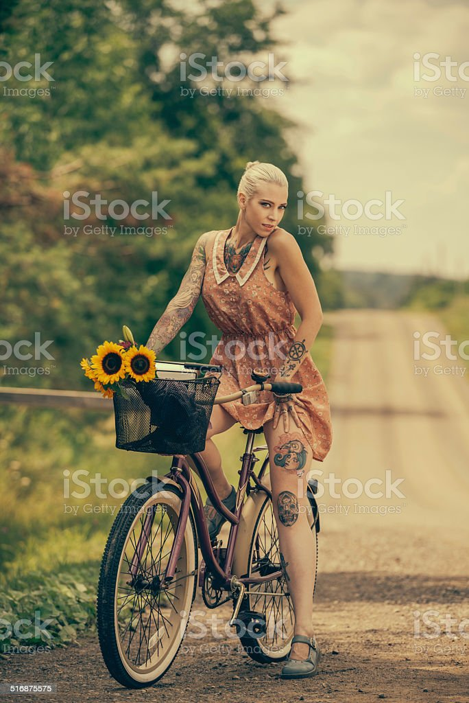Blonde woman with cruiser bicycle stock photo