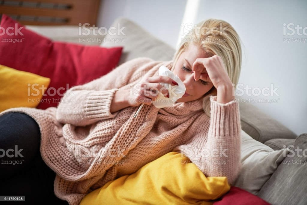 Blonde woman with flu stock photo