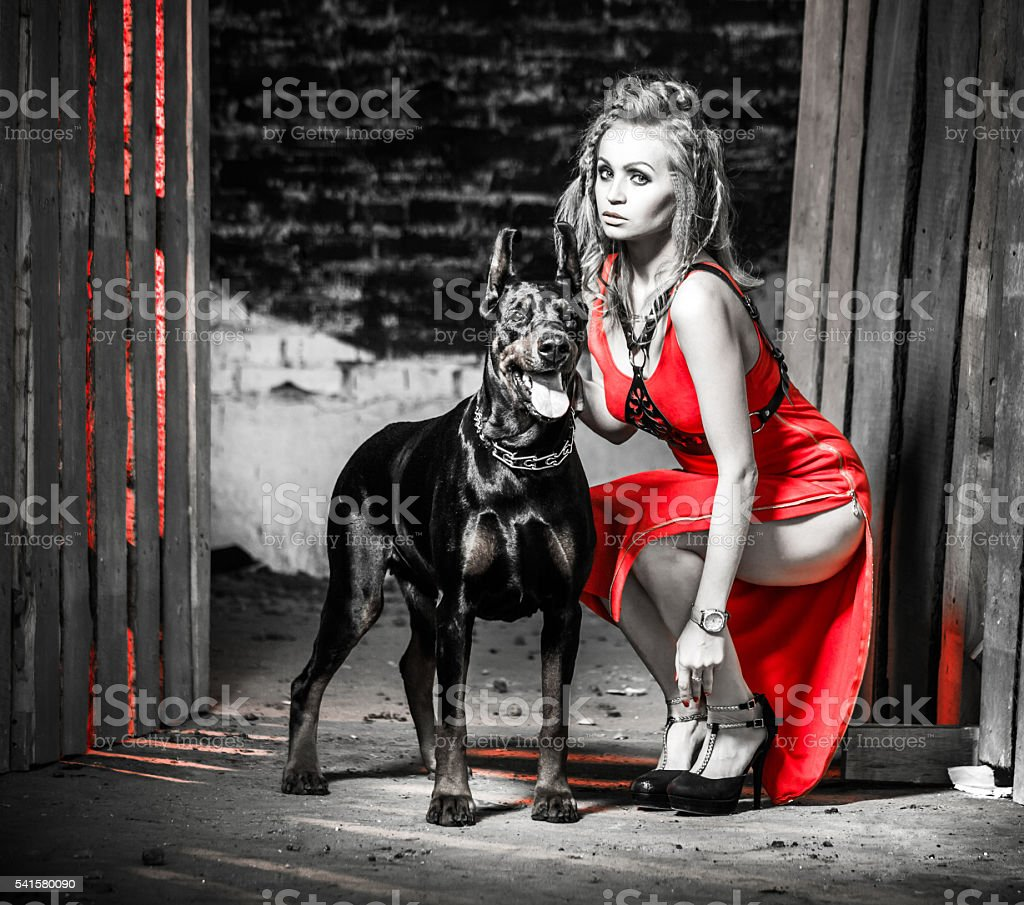 Blonde Woman With Her Doberman stock photo