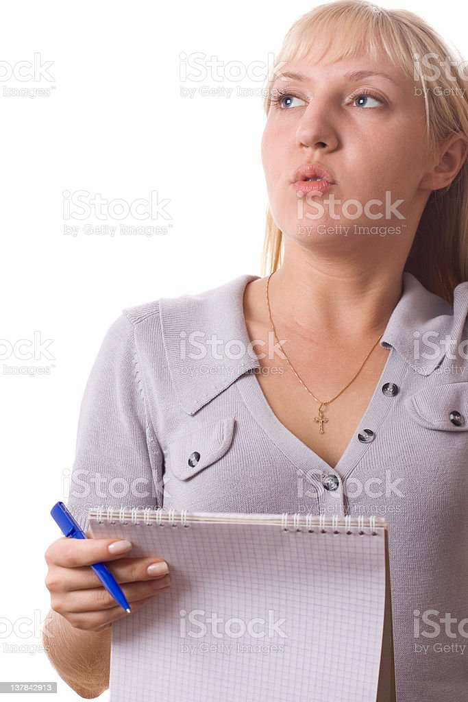 Blonde woman with note pad thinking. Isolated. royalty-free stock photo