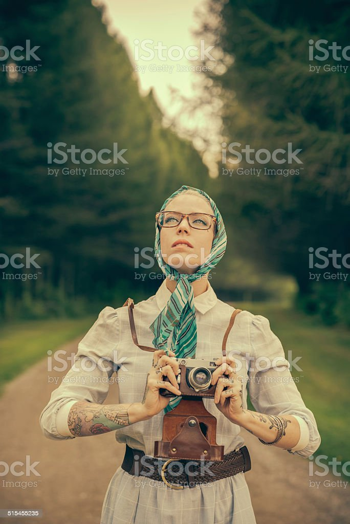 Blonde woman with the vintage rangefinder stock photo