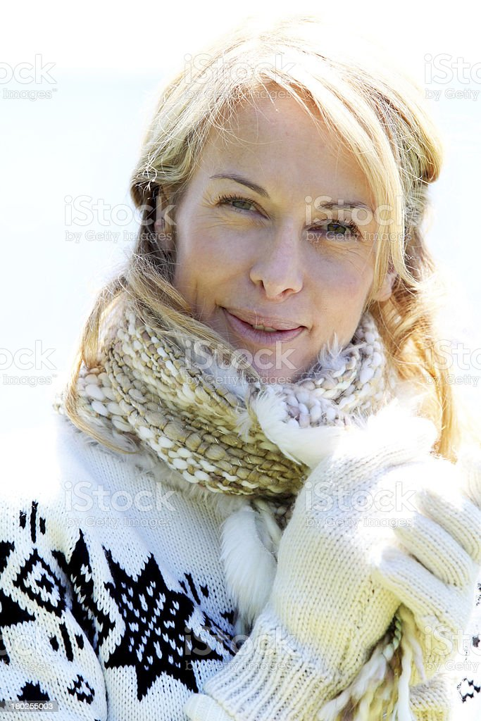 Blonde woman with winter clothes royalty-free stock photo