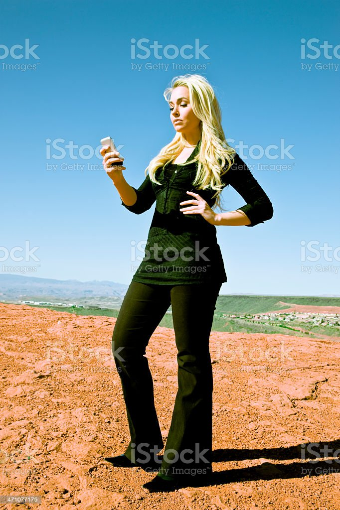 Blonde Woman writing Text Message royalty-free stock photo