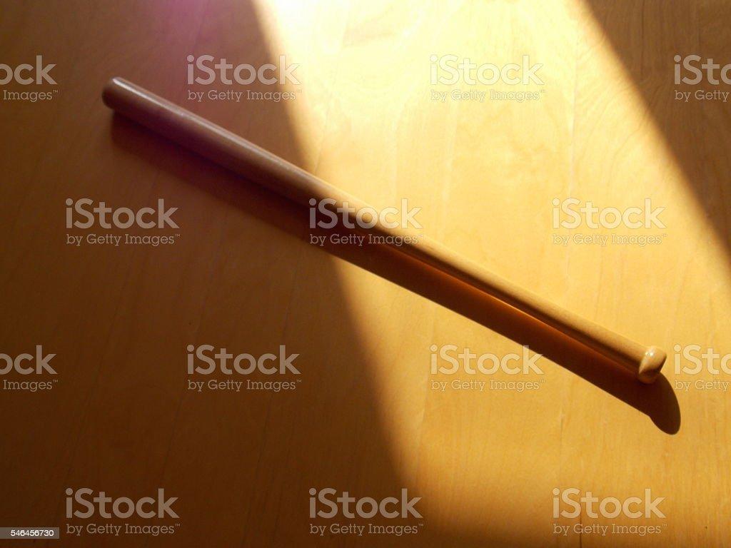 Blonde Wood Baseball Bat on Wood Background stock photo