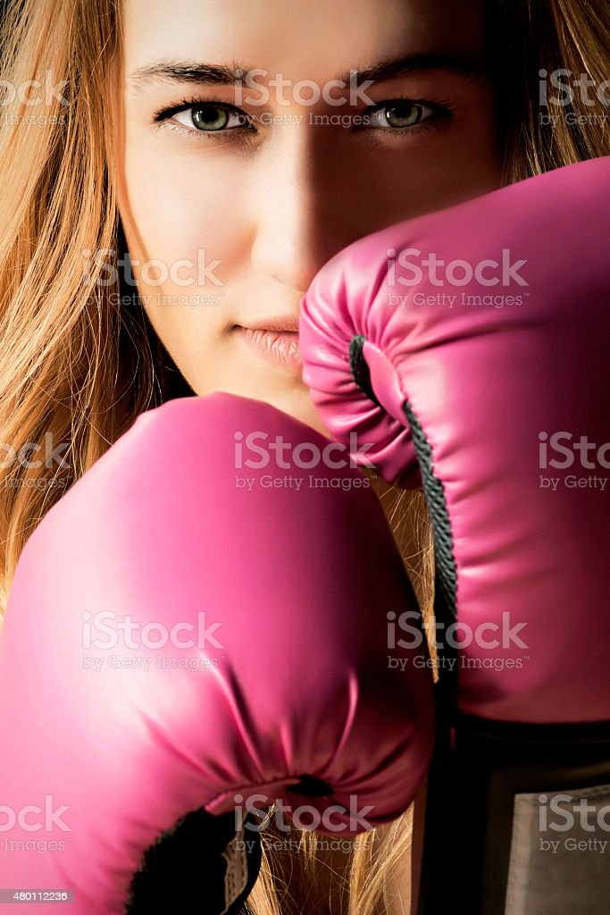 Blonde Young Boxing Woman with Pink Gloves Closeup stock photo