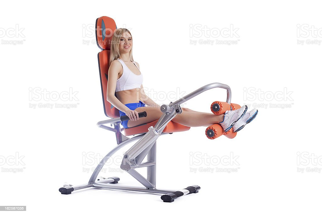 Blonde young woman on orange exerciser royalty-free stock photo