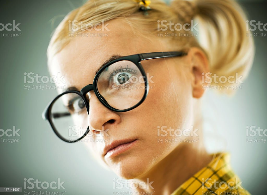Blonde young woman with a cross expression on her face. royalty-free stock photo