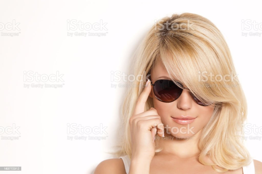 A blonde young woman with a sunglasses  royalty-free stock photo