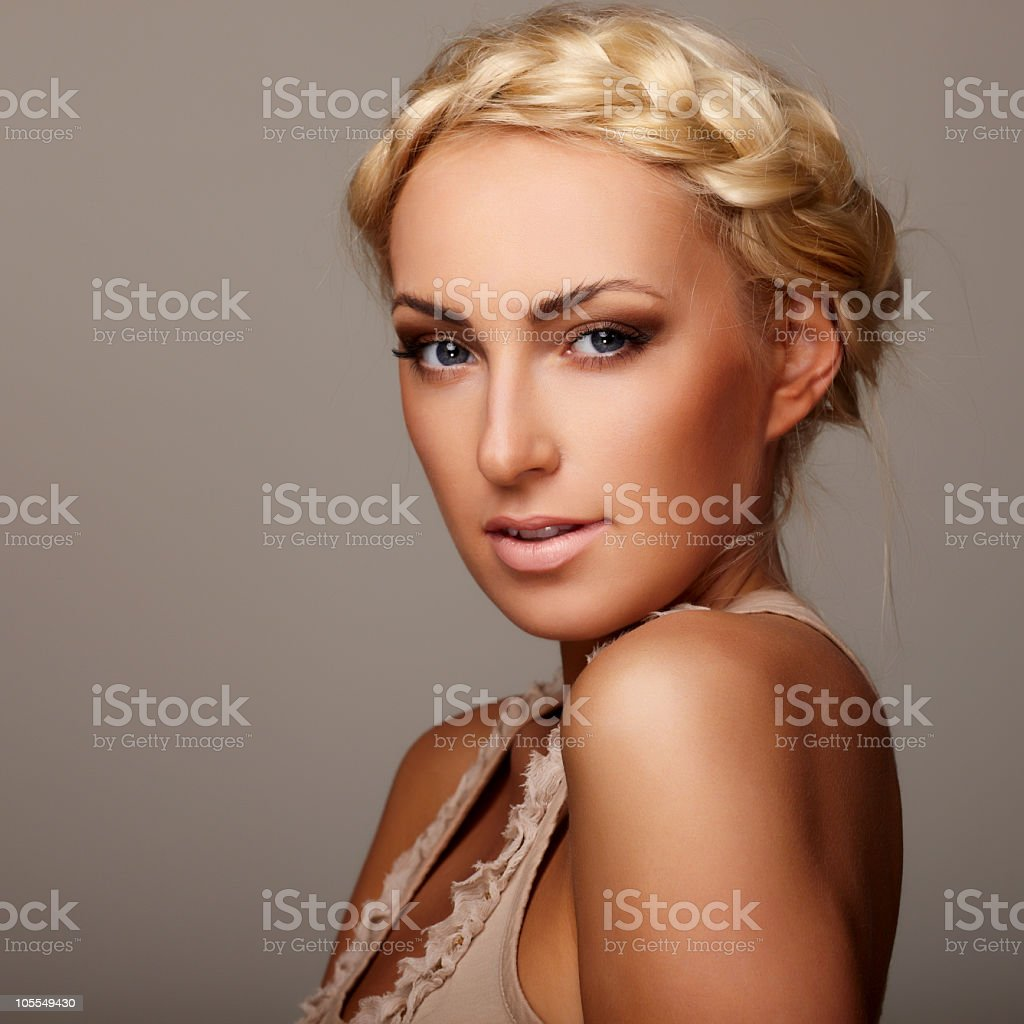 Blonde young woman with braided hair stock photo