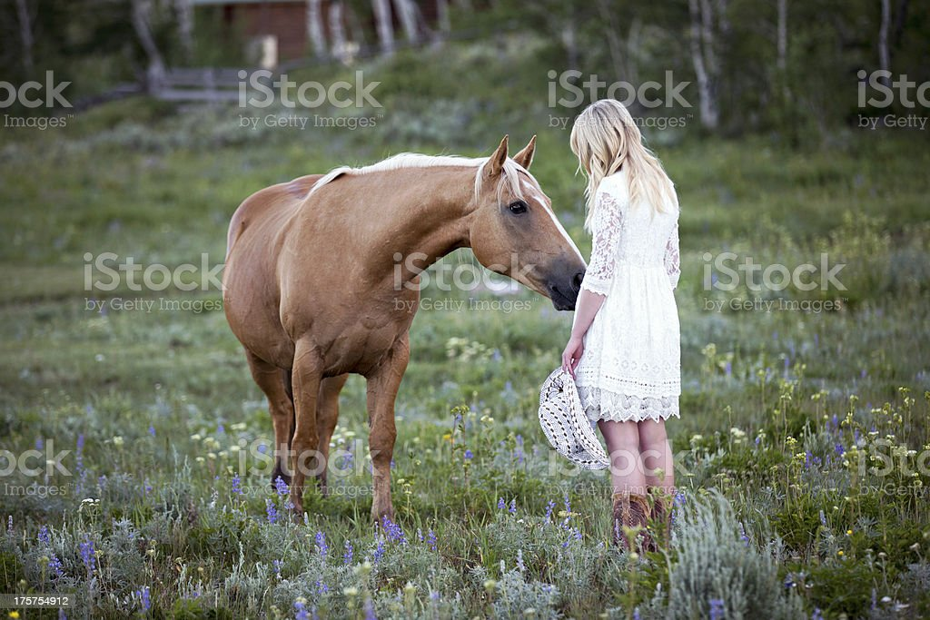 Blonde Young Woman With Palomino Horse royalty-free stock photo