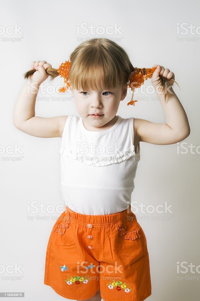 Blond-haired girl pulls the hair royalty-free stock photo